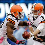Cleveland Browns quarterback Brandon Weeden (3) hands the ball off to running back Trent Richardson during the first half of an NFL football game against the New York Giants Sunday, Oct. 7,  …