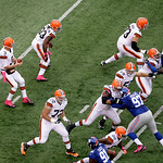 Cleveland Browns quarterback Brandon Weeden (3) drops back against the New York Giants during the first half of an NFL football game Sunday, Oct. 7, 2012, in East Rutherford, N.J. (AP Photo/ …