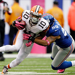 New York Giants outside linebacker Michael Boley (59) tackles Cleveland Browns wide receiver Jordan Norwood (10) during the second half of an NFL football game Sunday, Oct. 7, 2012, in East …