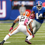 New York Giants running back Ahmad Bradshaw (44) runs with the ball as Cleveland Browns defensive back Buster Skrine (22) defends during the second half of an NFL football game Sunday, Oct.  …
