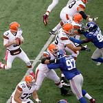 Cleveland Browns quarterback Brandon Weeden (3) drops back for a pas during the first half of an NFL football game Sunday, Oct. 7, 2012, in East Rutherford, N.J. (AP Photo/Peter Morgan)