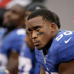 New York Giants defensive end Adrian Tracy sits on the bench during the second half of an NFL football game Sunday, Oct. 7, 2012, in East Rutherford, N.J. The Giants won the game 41-27. (AP …