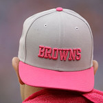 An NFL player wears a pink Clevelan Browns hat during the first half of an NFL football game during Breast Cancer Awareness month, Sunday, Oct. 7, 2012, in East Rutherford, N.J. (AP Photo/Pe …