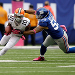 Cleveland Browns wide receiver Jordan Norwood (10) runs with the ball as New York Giants outside linebacker Michael Boley moves in for the tackle during the second half of an NFL football ga …