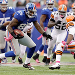 New York Giants tight end Martellus Bennett (85) runs away from Cleveland Browns free safety Usama Young (28) during the first half of an NFL football game Sunday, Oct. 7, 2012, in East Ruth …