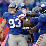 New York Giants middle linebacker Chase Blackburn (93) celebrates with teammates after intercepting a pass in the endzone during the second half of an NFL football game against the Cleveland …