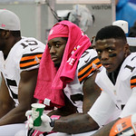 Cleveland Browns running back Trent Richardson, center, looks on with teammates Josh Gordon (13) and Greg Little (15) during the second half of an NFL football game Sunday, Oct. 7, 2012, i …