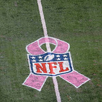 The Breast Cancer Awareness logo is shown on the field during the second half of an NFL football game between the Cleveland Browns and the New York Giants Sunday, Oct. 7, 2012, in East Ruthe …