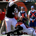 Cleveland Browns quarterback Brandon Weeden (3) throws under pressure from Cincinnati Bengals defensive back Jeromy Miles (45) in the first half of an NFL football game, Sunday, Sept. 16, 20 …