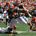 Cleveland Browns running back Trent Richardson (33) scores on a 23-yard pass reception in the second half of an NFL football game against the Cincinnati Bengals, Sunday, Sept. 16, 2012, in C …