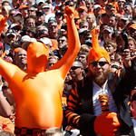 Cincinnati Bengals fans cheer during an NFL football game against the Cleveland Browns, Sunday, Sept. 16, 2012, in Cincinnati. (AP Photo/Tom Uhlman)