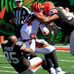 Cincinnati Bengals quarterback Andy Dalton (14) is sacked by Cleveland Browns defensive end Juqua Parker (95) and defensive tackle Billy Winn (90) in the first half of an NFL football game, …