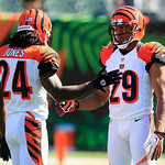 Cincinnati Bengals cornerback Adam Jones (24) and cornerback Leon Hall (29) warm up prior to an NFL football game against the , Sunday, Sept. 16, 2012, in Cincinnati. (AP Photo/Al Behrman)