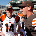 Cincinnati Bengals quarterback Andy Dalton (14) meets with quarterback Brandon Weeden (3) after an NFL football game, Sunday, Sept. 16, 2012, in Cincinnati. (AP Photo/Tom Uhlman)