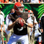 Cleveland Browns quarterback Brandon Weeden looks to pass against the Cincinnati Bengals in the first half of an NFL football game, Sunday, Sept. 16, 2012, in Cincinnati. (AP Photo/David Koh …