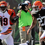 Cincinnati Bengals wide receiver Brandon Tate (19) runs past Cleveland Browns free safety Eric Hagg (27) on his way to a touchdown on a pass reception in the second half of an NFL football g …
