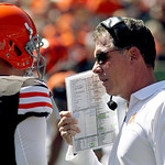 Cleveland Browns head coach Pat Shurmur, right, talks with quarterback Brandon Weeden (3) in the first half of an NFL football game against the Cincinnati Bengals, Sunday, Sept. 16, 2012, in …