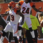 Cincinnati Bengals cornerback Adam Jones (24) and wide receiver Brandon Tate (19) celebrate after Tate scored a touchdown against the Cleveland Browns in the second half of an NFL football g …