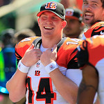 Cincinnati Bengals quarterback Andy Dalton smiles in the first half of an NFL football game against the Cleveland Browns, Sunday, Sept. 16, 2012, in Cincinnati. (AP Photo/David Kohl)