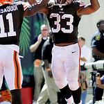 Cleveland Browns running back Trent Richardson (33) celebrates with Mohamed Massaquoi (11) after scoring on a pass reception in the second half of an NFL football game against the Cincinnati …