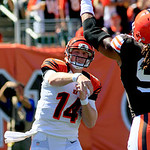 Cincinnati Bengals quarterback Andy Dalton (14) has a pass knocked down by Cleveland Browns defensive end Jabaal Sheard in the first half of an NFL football game, Sunday, Sept. 16, 2012, in …