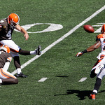 Cleveland Browns kicker Phil Dawson (4) kicks a field goal past Cincinnati Bengals cornerback Nate Clements (22) in the first half of an NFL football game, Sunday, Sept. 16, 2012, in Cincinn …