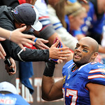 Buffalo Bills safety George Wilson celebrates with fans after a 24-14 win over the Cleveland Browns in an NFL football game Sunday, Sept. 23, 2012, in Cleveland. (AP Photo/David Richard)