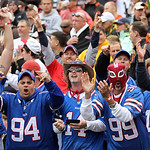 Buffalo Bills fans cheer after a Bills&#039; touchdown in the fourth quarter of an NFL football game against the Cleveland Browns, Sunday, Sept. 23, 2012, in Cleveland. (AP Photo/Tony Dejak)