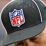 Rain beads on an officials cap during the first quarter of an NFL football game between the Cleveland Browns and Buffalo Bills Sunday, Sept. 23, 2012, in Cleveland. (AP Photo/David Richard)