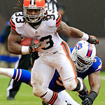 Cleveland Browns running back Trent Richardson (33) escapes a tackle by Buffalo Bills linebacker Mario Williams in the first quarter of an NFL football game Sunday, Sept. 23, 2012, in Clevel &#8230;