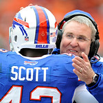 Buffalo Bills linebacker coach Bob Sanders, right, hugs Bryan Scott (43) near the end of a 24-14 win over the Cleveland Browns in an NFL football game Sunday, Sept. 23, 2012, in Cleveland. ( &#8230;