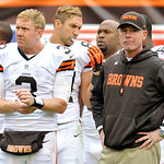 Cleveland Browns quarterback Brandon Weeden (3) stands on the sidelines with head coach Pat Shurmur in the final moments of a 24-14 loss to the Cleveland Browns in an NFL football game on Su &#8230;