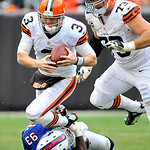 Cleveland Browns quarterback Brandon Weeden (3) is sacked by Buffalo Bills defensive end Mark Anderson (93) in the fourth quarter of an NFL football game Sunday, Sept. 23, 2012, in Cleveland &#8230;