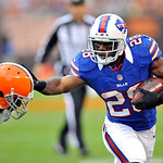 Buffalo Bills running back C.J. Spiller (28) pushes away Cleveland Browns safety T.J. Ward (43) on a short run in the first quarter of an NFL football game on Sunday, Sept. 23, 2012, in Clev &#8230;
