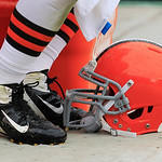 A Cleveland Browns helmet rests on the gorund during an NFL football game against the Buffalo Bills Sunday, Sept. 23, 2012, in Cleveland. (AP Photo/Tony Dejak)