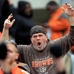 A Cleveland Browns fan yells from the Dawg Pound during the fourth quarter of an NFL football game against the Buffalo Bills Sunday, Sept. 23, 2012, in Cleveland. (AP Photo/Tony Dejak)