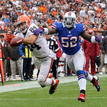 Cleveland Browns tight end Jordan Cameron (84) can&#039;t hold onto the ball as Buffalo Bills outside linebacker Arthur Moats (52) defends during an NFL football game Sunday, Sept. 23, 2012, in C &#8230;