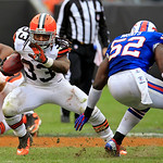 Cleveland Browns running back Trent Richardson (33) gets past Buffalo Bills linebacker Arthur Moats (52) in the third quarter of an NFL football game Sunday, Sept. 23, 2012, in Cleveland. (A &#8230;