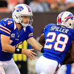 Buffalo Bills quarterback Ryan Fitzpatrick (14) hands the ball to C.J. Spiller (28) during an NFL football game against the Cleveland Browns Sunday, Sept. 23, 2012, in Cleveland. (AP Photo/T &#8230;
