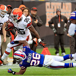 Cleveland Browns running back Chris Ogbonnaya (25) runs past Buffalo Bills cornerback Justin Rogers (26) in the second quarter of an NFL football game Sunday, Sept. 23, 2012, in Cleveland. ( &#8230;