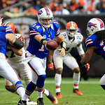 Buffalo Bills quarterback Ryan Fitzpatrick (14) hands off the ball to Johnny White (29) during an NFL football game against the Cleveland Browns Sunday, Sept. 23, 2012, in Cleveland. (AP Pho &#8230;