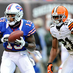 Buffalo Bills wide receiver Steve Johnson (13) catches a 9-yard touchdown pass in front of Cleveland Browns cornerback Dimitri Patterson (21) in the fourth quarter of an NFL football game on &#8230;