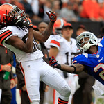 Cleveland Browns wide receiver Travis Benjamin (80) can&#039;t hold onto the ball as Buffalo Bills cornerback Aaron Williams (23) defends during an NFL football game Sunday, Sept. 23, 2012, in Cl &#8230;
