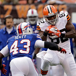 Cleveland Browns tight end Benjamin Watson (82) catches a pass against Buffalo Bills safety Bryan Scott (43) in the first quarter of an NFL football game Sunday, Sept. 23, 2012, in Cleveland &#8230;