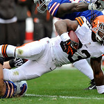 Cleveland Browns running back Trent Richardson (33) is tackled for a loss by Buffalo Bills nose tackle Kyle Williams in the first quarter of an NFL football game Sunday, Sept. 23, 2012, in C &#8230;