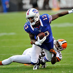 Buffalo Bills wide receiver Steve Johnson (13) is tripped up by Cleveland Browns cornerback Sheldon Brown after a pass reception in the first quarter of an NFL football game Sunday, Sept. 23 &#8230;