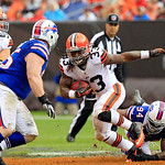 Cleveland Browns running back Trent Richardson (33) escapes Buffalo Bills linebacker Mario Williams in the second quarter of an NFL football game Sunday, Sept. 23, 2012, in Cleveland. (AP Ph &#8230;