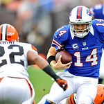 Buffalo Bills quarterback Ryan Fitzpatrick (14) runs against Cleveland Browns cornerback Buster Skrine (22) in the second quarter of an NFL football game Sunday, Sept. 23, 2012, in Cleveland &#8230;