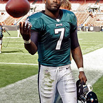 Philadelphia Eagles quarterback Michael Vick tosses a ball to a fan after a 17-16 win over the Cleveland Browns in an NFL football game on Sunday, Sept. 9, 2012, in Cleveland. (AP Photo/Ron  …