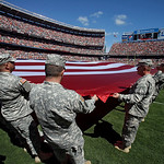 Army National Guard soldiers hold a large American flag on the field before an NFL football game between the Cleveland Browns and the Philadelphia Eagles Sunday, Sept. 9, 2012, in Cleveland. …